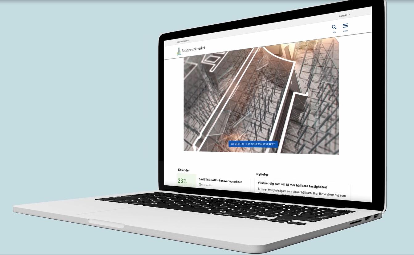 En laptopdator mot en blå bakgrund. Datorn visar Fastighetsnätverkets nya webbplats.